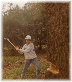 chopping a tree with an ax